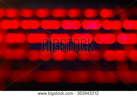 Unfocused Blured Red And Black Background Bokeh. Non Focused. Bokeh Abstact Texture. Defocussed Back