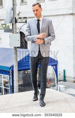 Young Businessman Street Fashion In New York City. Young European Man Wearing Gray Blazer, White Shi
