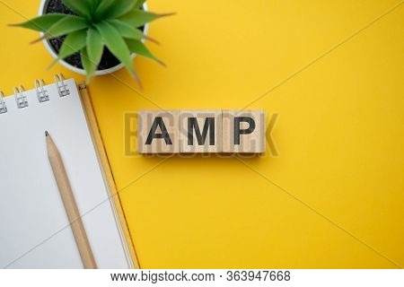 Modern Marketing Buzzword Amp - Accelerated Mobile Pages. Top View On Wooden Table With Blocks. Top