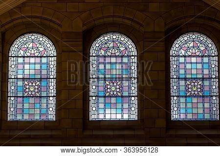 Trio Of Stained Glass Windows. Three Ornate Purple Pink Window Designs. Beautiful Stain Glass Arch W