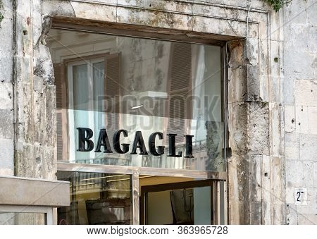 Siracusa, Sicily - February 13, 2020: The Storefront Of The Furla Bagagli Boutique Which Sells Bags