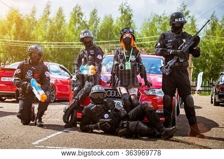 Moscow, Russia - July 06, 2019: Special Forces Soldiers Guard The Car. Cosplay, Anime Fighters With