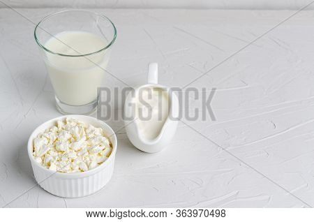 Homemade Fermented Drink In A Glass Of Kefir, Cottage Cheese, Sour Cream On A White Background, Copy