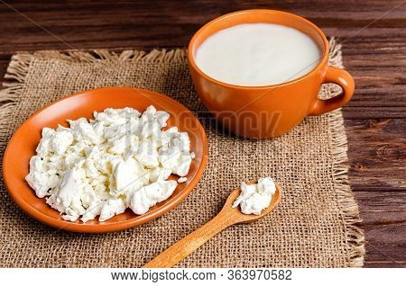 Homemade Fermented Milk Products - Kefir, Cottage Cheese On Burlap On A Wooden Background. Healthy E