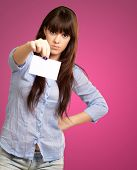 Portrait Of A Girl Holding And Angry On Pink Background poster