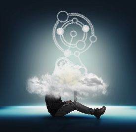 Businessman Working On Lapton With Head Into A Cloud . Network And Cloud Storage Concept . Team Work