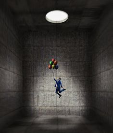 Businessman Flying With Balloons From A Dark Concrete Room Through A Hole . Finding Solution In Toug