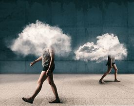 People Walking Outdoor With The Head Inside A Cloud . Mental Illness Concept.