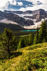 The Rocky Mountains. Magnificent Scenic Viev Of  Crowfoot Glacier & Crowfoot Mountain  From The Hiki