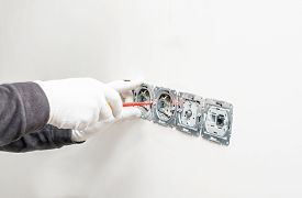The Process Of Installing Internal Sockets On A Background Of White Gypsum Wall