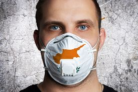 Young Man With Sore Eyes In A Medical Mask Painted In The Colors Of The National Flag Of Cyprus. Cor