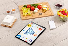 Healthy Tablet Pc compostion with START DIET TODAY inscription, weight loss concept