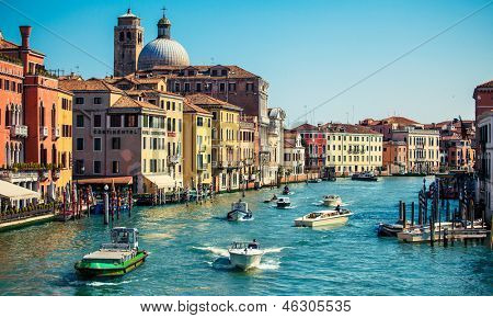 grand channel with boats and color architecture in Venice, Italy