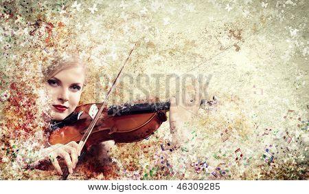 Gorgeous woman playing violin