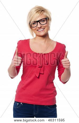 Beautiful woman with glasses showing thumbs up