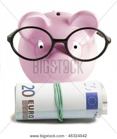 Piggy bank isolated and twenty euro on white background