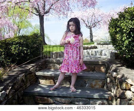 Little Girl Holding A Flower