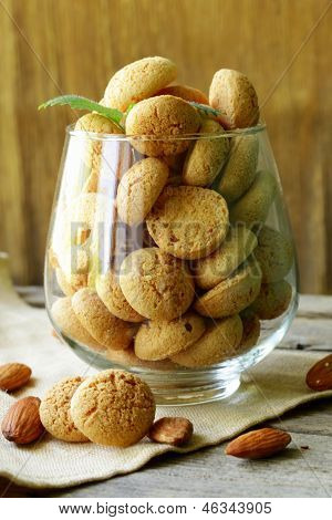 sweet almond cookies biscuits (amaretti) on the table poster