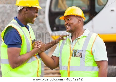 cheerful african mine workers hands together to form brotherhood