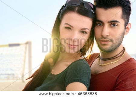 Close-up portrait of romantic young couple on the beach.