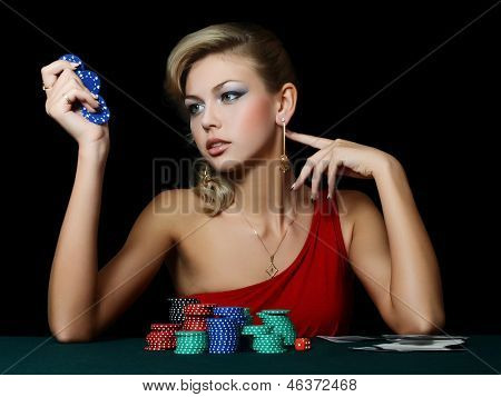 Beautiful woman with casino chips a black