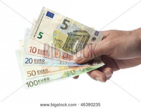 Hand with euro bills from 5 to 100 isolated on white. Including new 5 Euro bill issued in 2013.