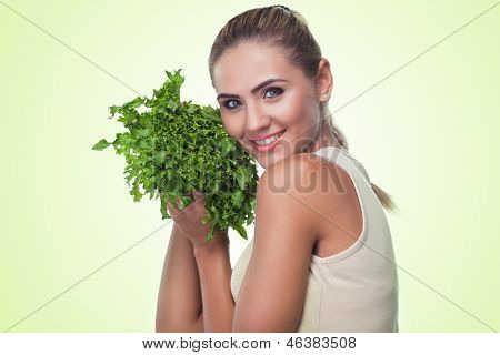 Happy Young Woman With Bundle Herbs (salad) In Hands On White Background. Concept Vegetarian Dieting