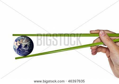 Blue Planet Earth Between Green Chopsticks