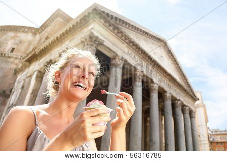 Girl eating ice cream by Pantheon, Rome, Italy. Happy tourist woman laughing enjoying Italian gelato ice cream while sightseeing travel landmark destinations in Rome. Beautiful blonde female model.
