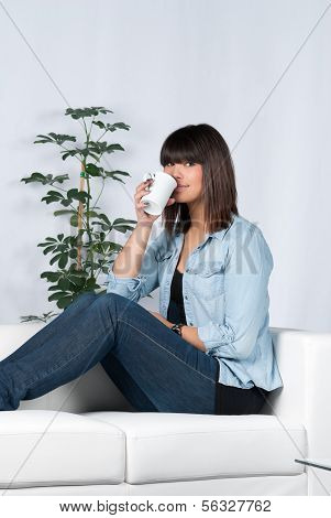 Woman Drinks A Cup Of Coffee