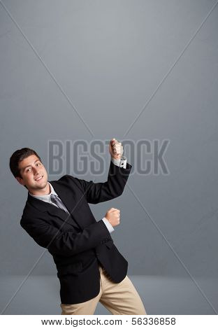 Attractive young man gesturing with copy space