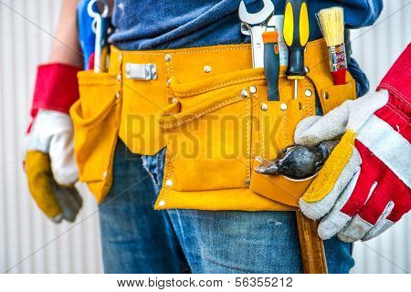 man and tools in leathern belt