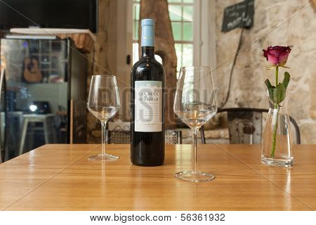 VENCE, FRANCE - SEPTEMBER 16: Table with wine and glasses at Bed and Bistrot on 16 September, 2013 in Vence, France. Bed and Bistrot is a new concept hotel in Vence.