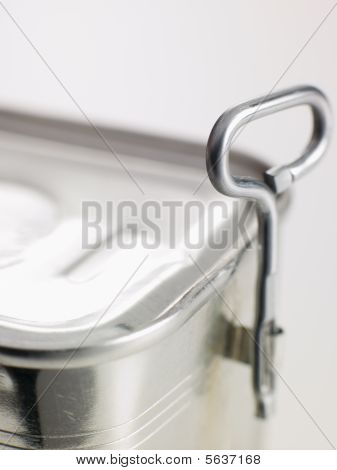 Close Up Of Opener On Tin Can