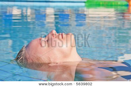 Young Blond Woman In Swimming Pool