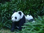 A Giant Panda constructed out of plastic building blocks. poster