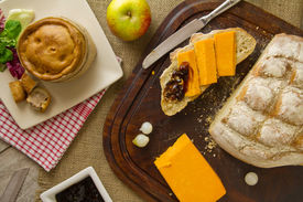 Ploughman's Lunch Spread From Above With Cut Bread
