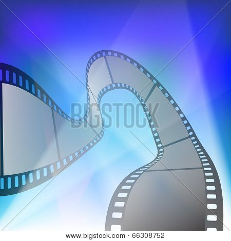Film strip in the rays of searchlights on blue background poster