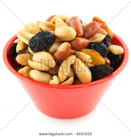 Mixed peanuts in a modern orange plastic bowl poster