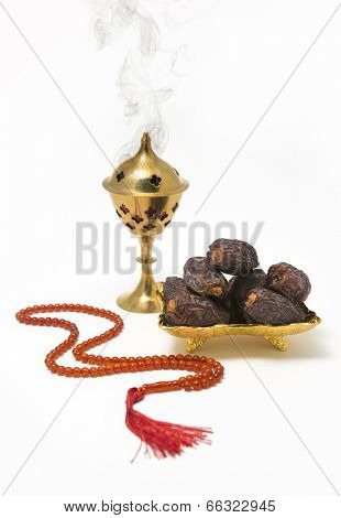 An Oudh burner, dates and islamic prayer beads poster