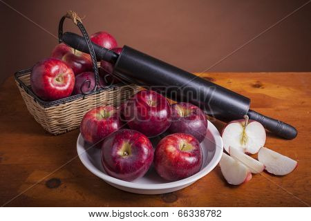 Fresh Cortland apples with a pie plate and rolling pin ready to bake a pie. poster