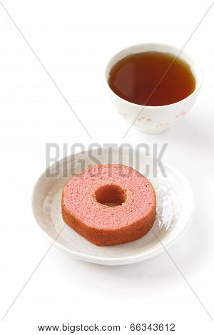 Strawberry baum cake and cup of tea