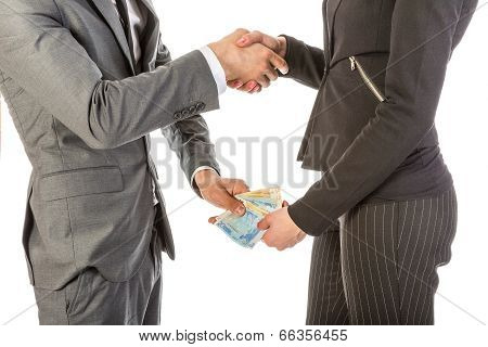 Man Gives Woman Money While Shaking Hands