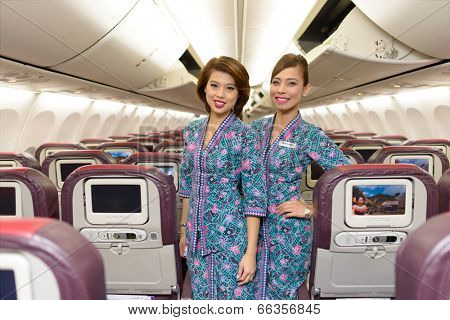 HONG KONG, CHINA - MAY 12, 2014: Malaysian Airline crew members posing in Boeing 737 aircraft after landing on MAY 12, 2014. Malaysian Airline System is the flag carrier airline of Malaysia