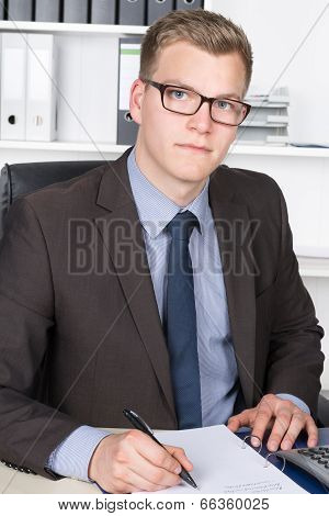 Young Man Is Writing Into A Document