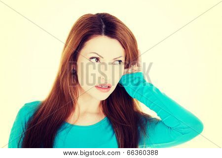 Surprised woman trying to listening a gossip.