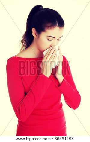 Teen woman with allergy or cold.