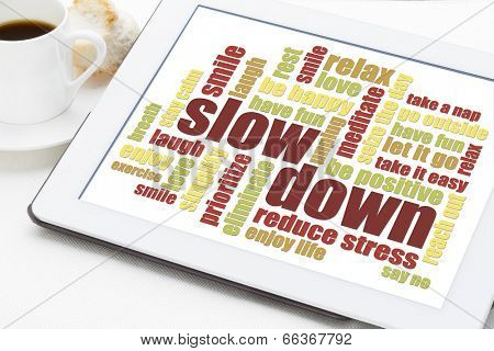 slow down and relax - reducing stress tips in a form of a word cloud on a digital tablet poster