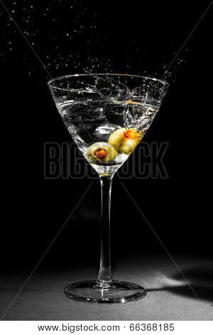 Martini Glass With Two Splashing Olives