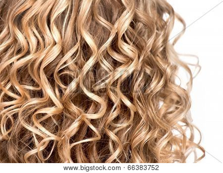 Curly blonde hair closeup. Wavy blond hair background. Close up texture of permed hair. Hairstyle